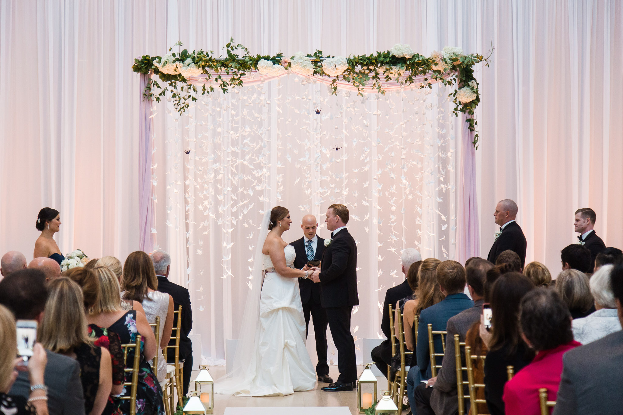 Elegant_Event_Lighting_Chicago_Art_Institute_Griffin_Court_Wedding_Ceremony_Arch_Cranes_White_Draping_Backdrop_Blush_Pink