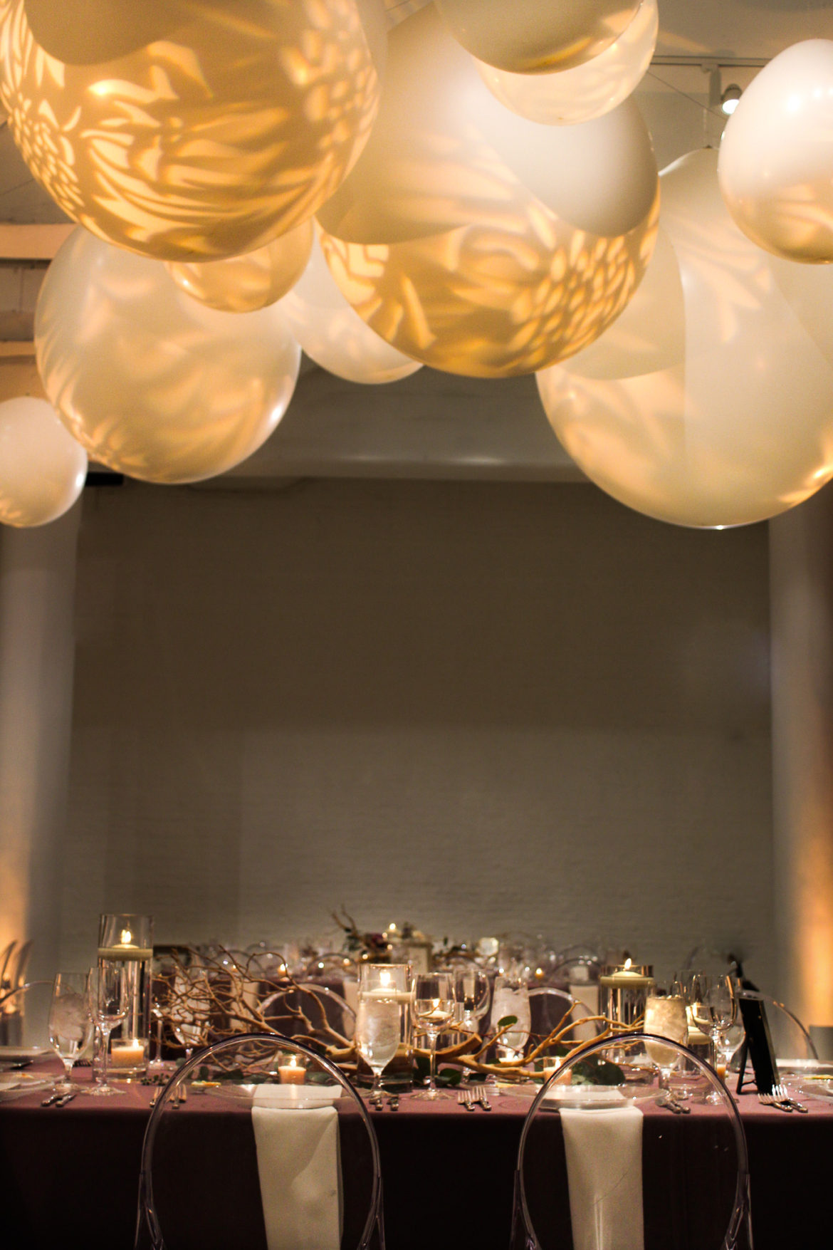 Elegant_Event_Lighting_Chicago_Chez_Wedding_Head_Table_Giant_Balloons_Pattern_Lighting