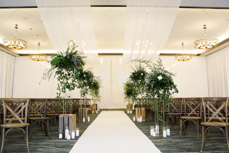 Elegant_Event_Lighting_Chicago_Edgewater_Wisconsin_Wedding_White_Entrance_Draping_greenery_Aisle_Runner
