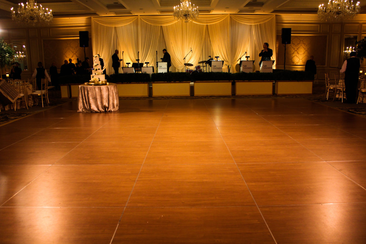 Elegant_Event_Lighting_Chicago_Four_Seasons_Wedding_Dance_Floor_Lighting_Amber_Ivory_BAckdrop_Band