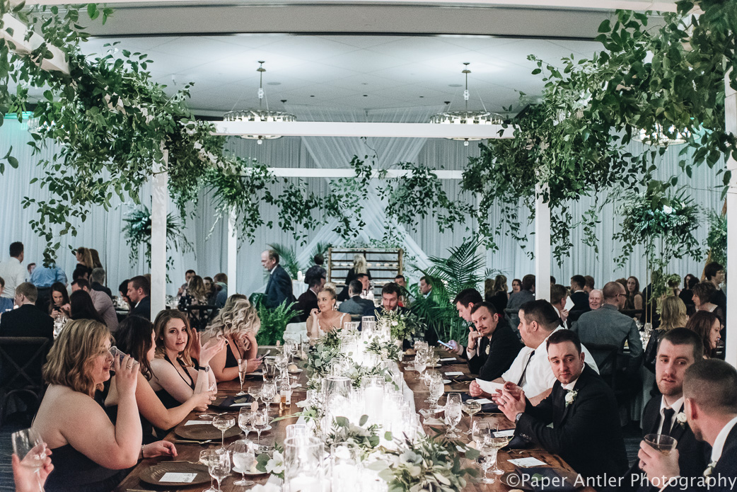 Elegant_Event_Lighting_Edgewater_Hotel_Wisconsin_Wedding_Head_Table_Reception_White_Room_Draping