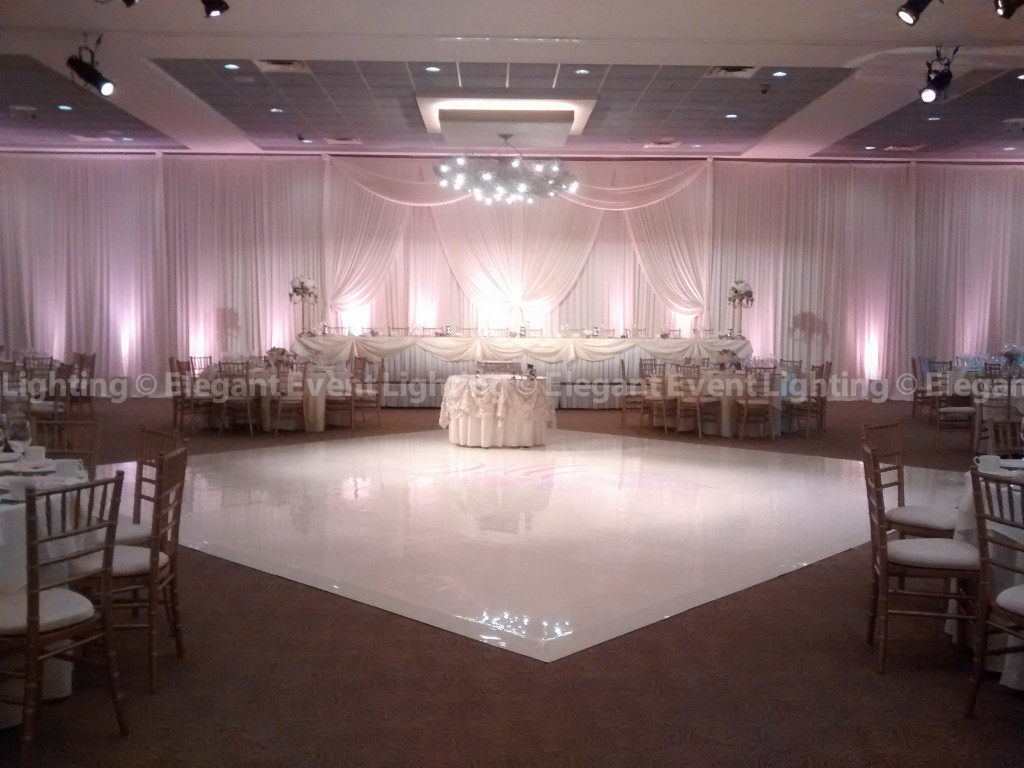 Ivory Head Table Backdrop with Blush Pink Uplighting