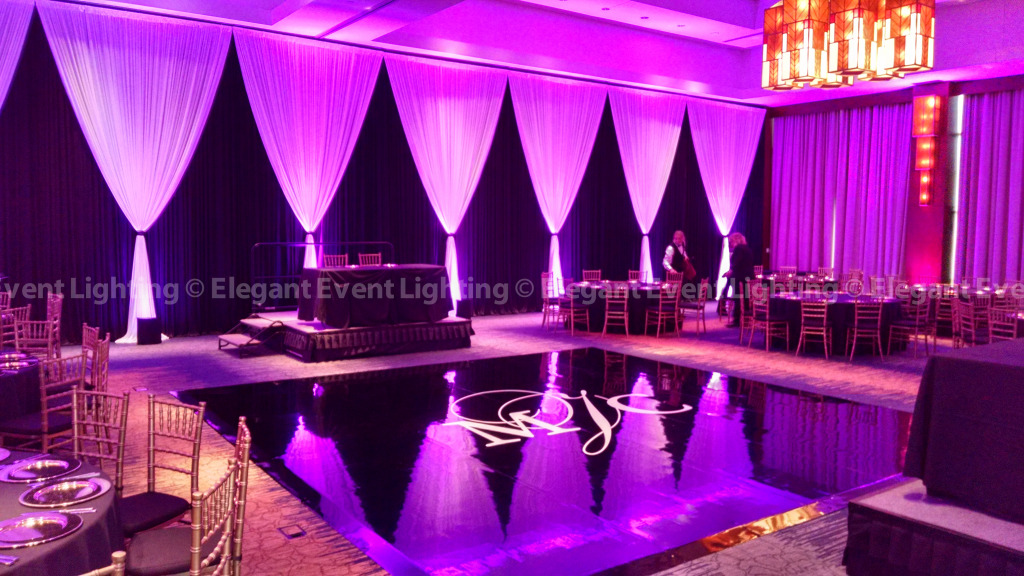 Black Vinyl Dance Floor, Wall Draping & Uplighting | Eaglewood Resort & Spa