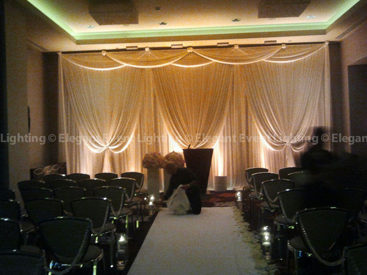 Ivory Ceremony Backdrop & Amber Uplighting | Dickens Ballroom - The Wit