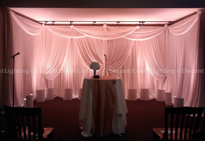 Ivory Ceremony Backdrop & Warm Amber Uplighting | River Roast