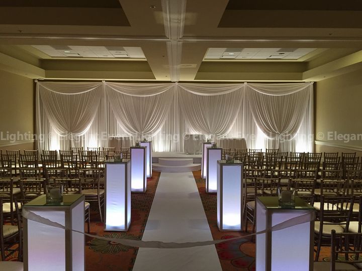 Ceremony Backdrop, Uplighting, Stage Cover, Aisle Runner & Lighted Flower Pedestals | Hilton Oak Brook Hills Resort