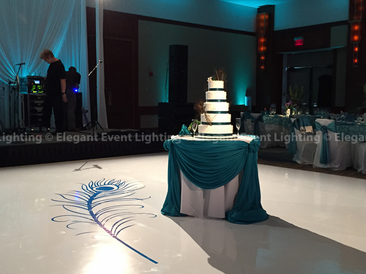 Wedding Cake Table Swagging & White Dance Floor with Feather Overlay | Eaglewood Resort & Spa