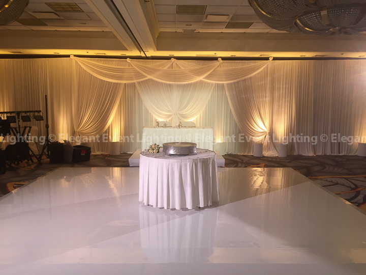 Sweetheart Table Backdrop, Soft Amber Uplighting & White Dance Floor | Majestic Ballroom - Hilton Lisle