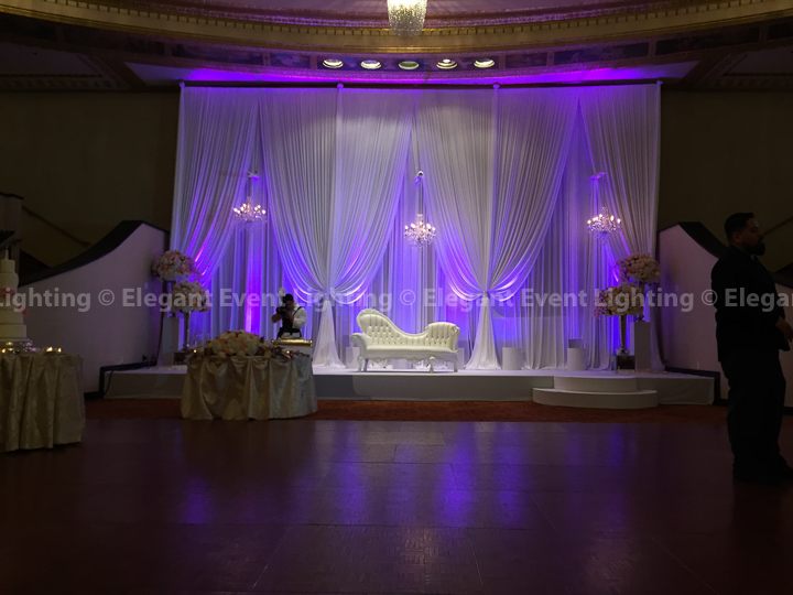 Wedding Backdrop with Purple Uplighting, Crystal Chandeliers, White Stage Cover & Moon Steps | Intercontinental Hotel Chicago