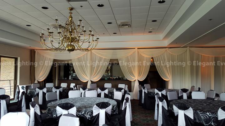 Ivory Fabric Drape Wall & Amber Uplighting | Riverside Golf Club