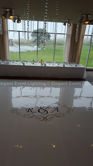 White Dance Floor, Custom Monogram, Hanging Crystals & Soft Pink Uplighting | Illinois Beach Resort