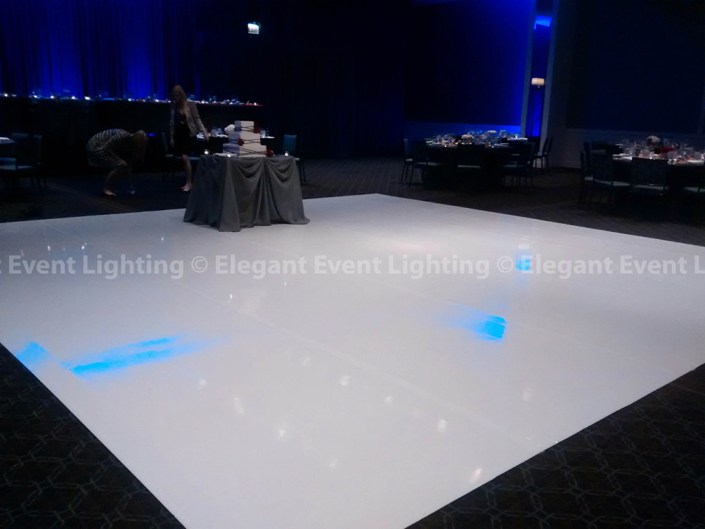 White Vinyl Dance Floor & Blue Uplighting | Hotel Arista