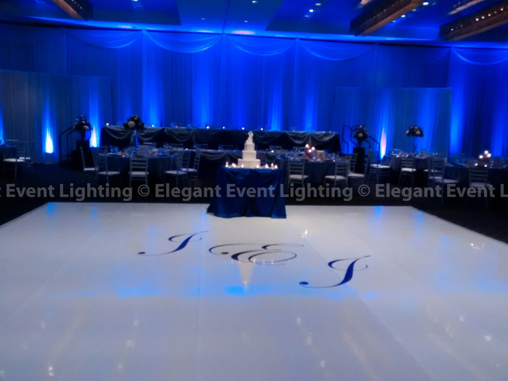 White Draping, Purple Uplighting & White Vinyl Dance Floor | Hotel Arista