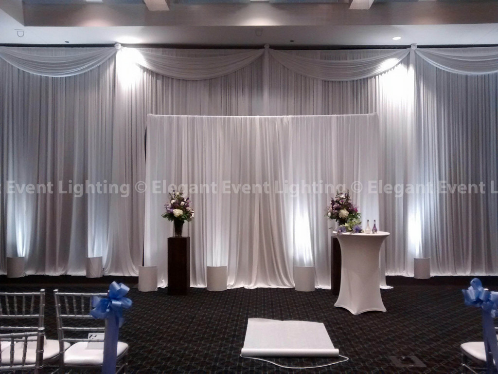 White Ceremony Draping i& White Uplighting | Hotel Arista