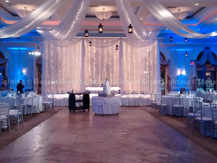 Fairy Light Backdrop, Ceiling Canopy, Iron Lanterns & Blue Uplighting | Venuti's