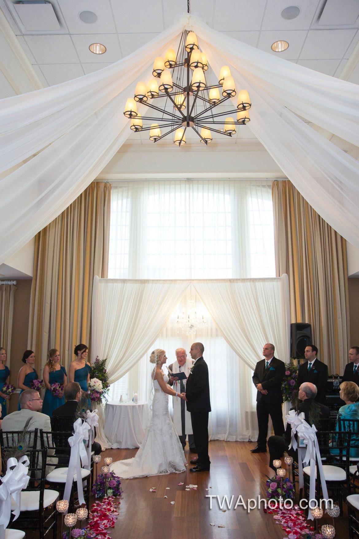 Elegant_Event_Lighting_Chicago_Arrowhead_Golf_Club_Wheaton_Wedding_Ceiling_Drapes_Ivory_Bridal_Arch_Ceremony_Crystal_Chandelier