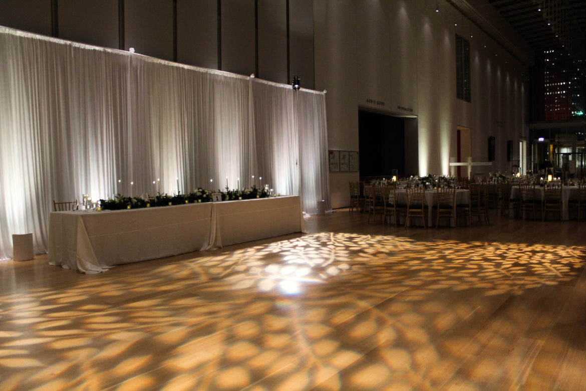 Elegant_Event_Lighting_Chicago_Art_Institute_Griffin_Court_Wedding_Pattern_Dance_Floor_Lighting_White_Draping_Backdrop_Soft_LED_Uplighting