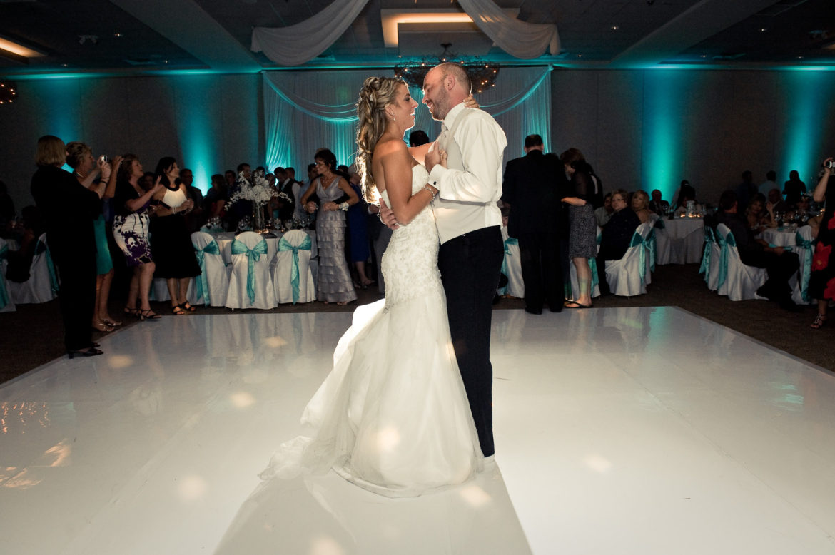 Elegant_Event_Lighting_Chicago_Belvedere_Banquets_Elk_Grove_Wedding_White_Dance_Floor_Vinyl_Teal_LED_Uplighting_First_Dance_Backdrop