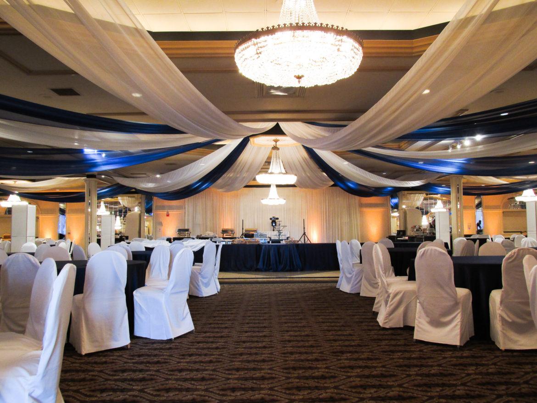 Elegant_Event_Lighting_Chicago_Carlisle_Wedding_Amber_Uplighting_Ivory_Backdrop_Ceiling_Drapes