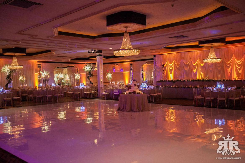 Elegant_Event_Lighting_Chicago_Carlisle_Wedding_Amber_Uplighting_Ivory_Backdrop_Draping_White_Vinyl_Dance_Floor