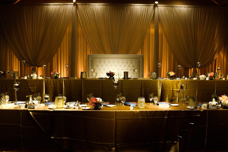 Elegant_Event_Lighting_Chicago_Carlisle_Wedding_Amber_Uplighting_Ivory_Backdrop_Loveseat