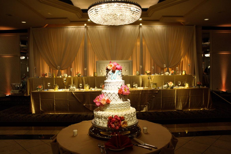 Elegant_Event_Lighting_Chicago_Carlisle_Wedding_Amber_Uplighting_Ivory_Backdrop_Loveseat_Cake_Light_Elegant