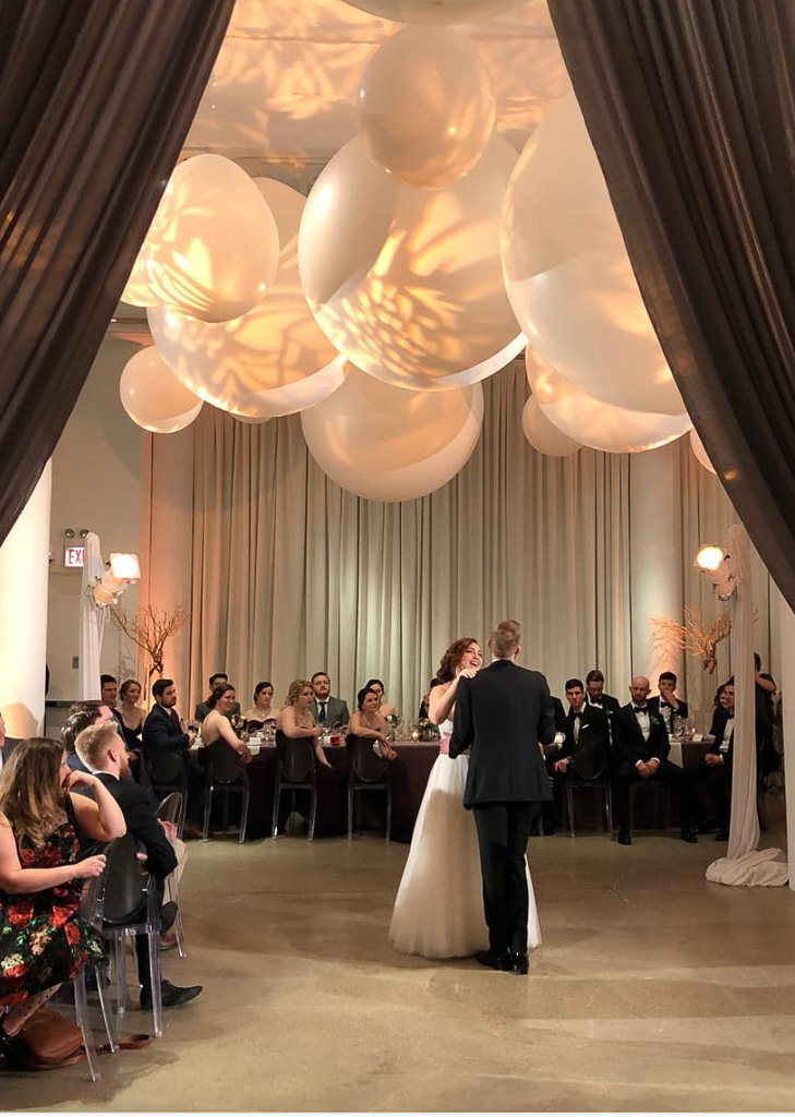 Elegant_Event_Lighting_Chicago_Chez_Wedding_Ceremony_Peach_Uplighting_Silver_Draping_First_Dance