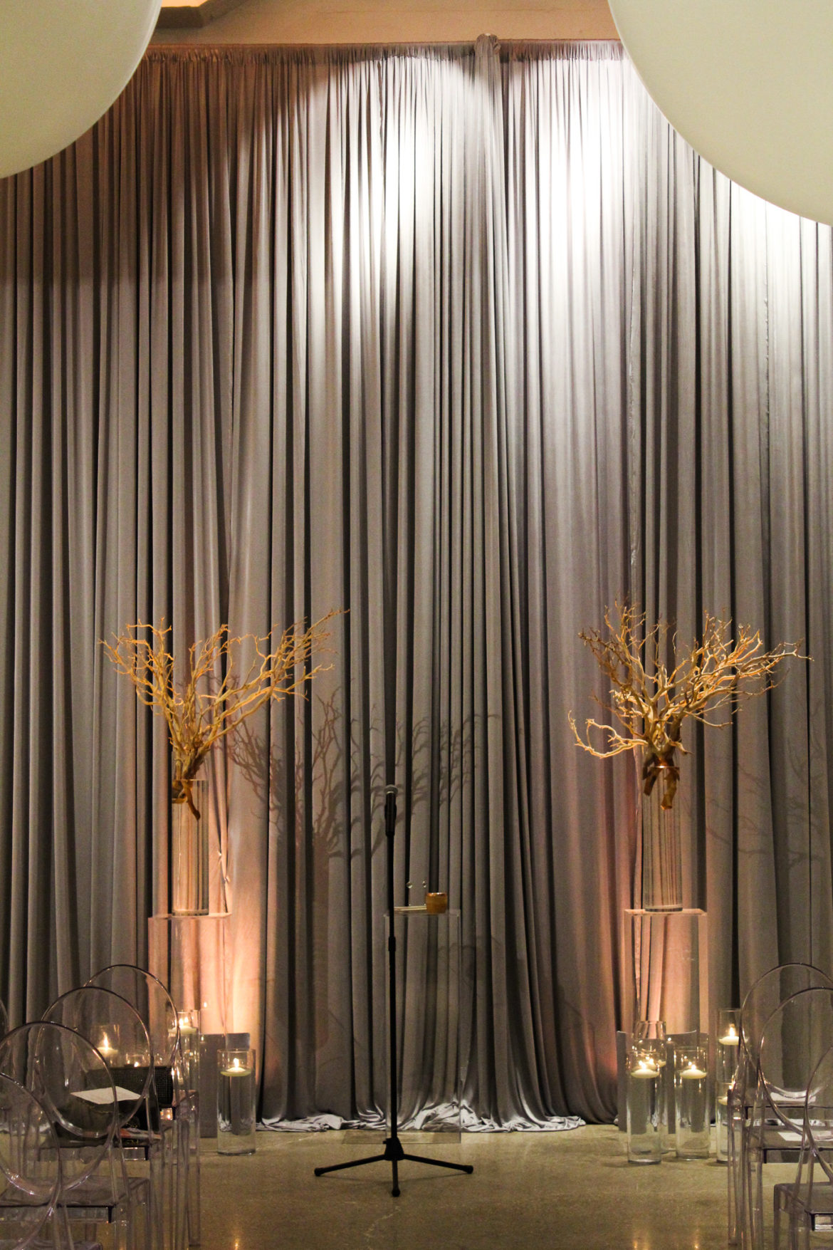 Elegant_Event_Lighting_Chicago_Chez_Wedding_Ceremony_Silver_Draping_Peach_LED_Uplighting
