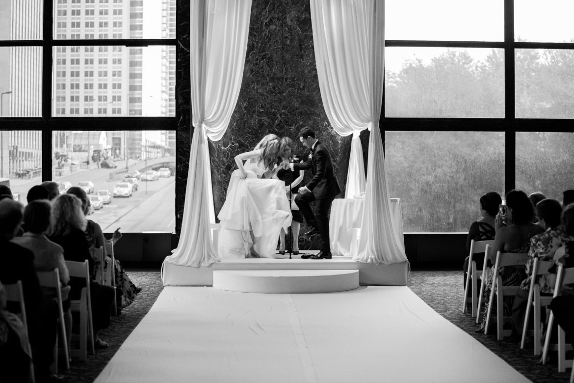Elegant_Event_Lighting_Chicago_Cultural_Center_GAR_Hall_Wedding_Draping_Bridal_Canopy_Ivory_Chuppah_Amber_LED_Uplighting_Ceremony_Stage_Cover_Aisle_Runner