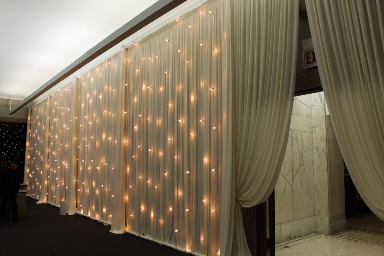 Elegant_Event_Lighting_Chicago_Cultural_Center_Mollenium_Park_Room_Wedding_Vertical_Cafe_Globe_String_Lighting_Backdrop_Draping_Entrance_Ivory_Rustiv_Romantic_Cocktail