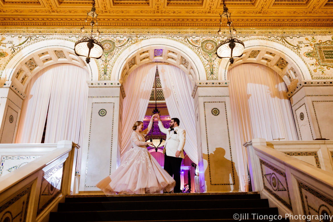 Elegant_Event_Lighting_Chicago_Cultural_Center_Preston_Bradley_Hall_Wedding_ Stairs_Dance_Ivory_Draping_Blush_PInk_Elegant_Fairy_Tale