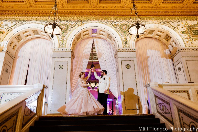 Elegant_Event_Lighting_Chicago_Cultural_Center_Preston_Bradley_Hall_Wedding_ Stairs_Dance_Ivory_Draping_Blush_PInk_Elegant_Fairy_Tale