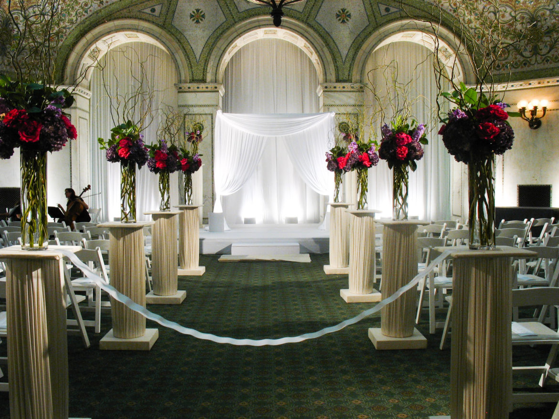 Elegant_Event_Lighting_Chicago_Cultural_Center_Preston_Bradley_Hall_Wedding_White_Arch_Ceremony_Satge_Cover_Draping
