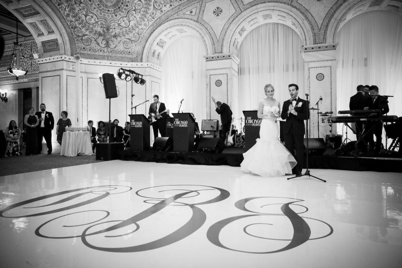 Elegant_Event_Lighting_Chicago_Cultural_Center_Preston_Bradley_Hall_Wedding_White_Dance_Floor_Monogram_Vinyl_Draping_Backdrop
