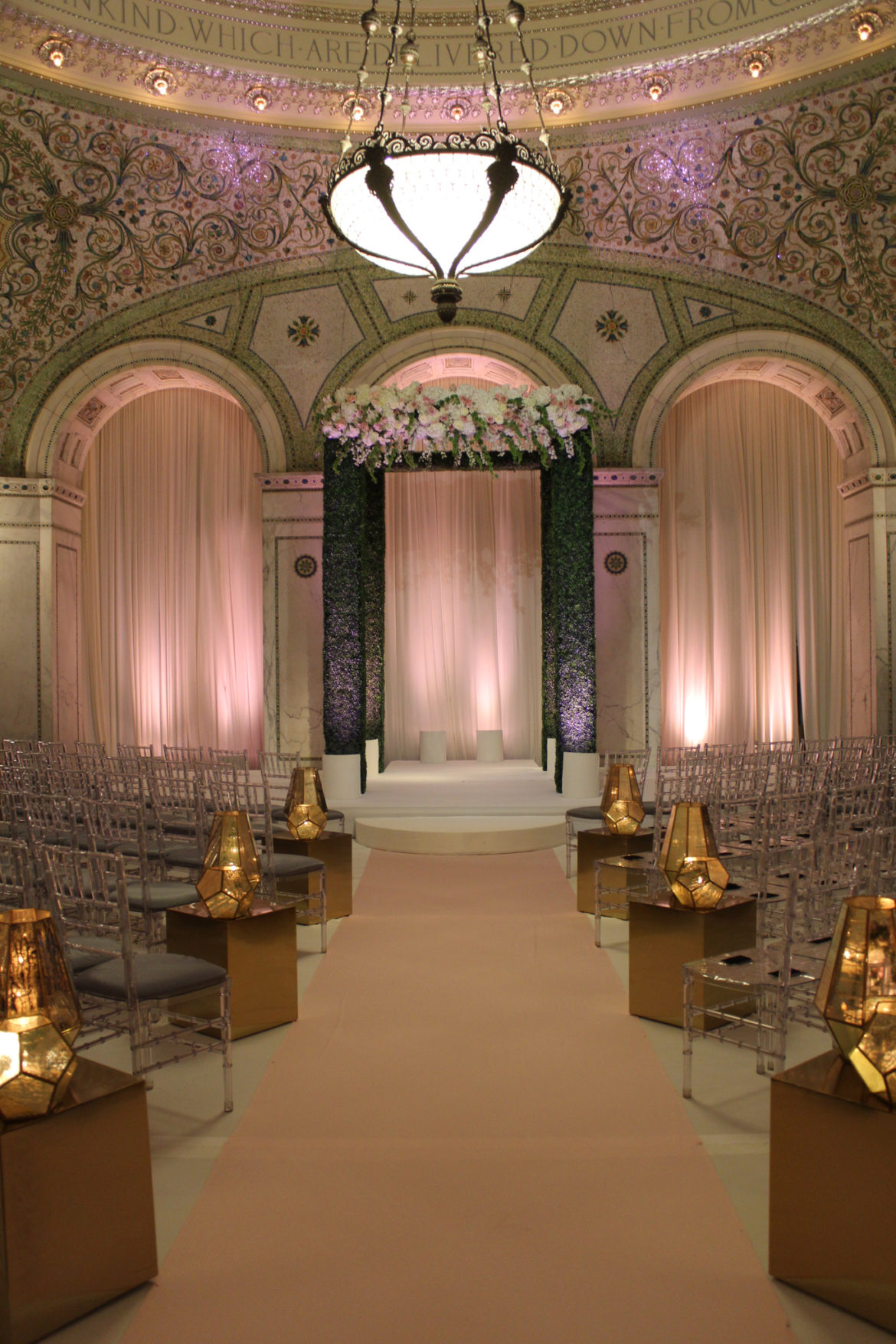 Elegant_Event_Lighting_Chicago_Cultural_Center_Preston_Bradley_Hall_White_Stage_Cover_Pink_Aisle_Runner