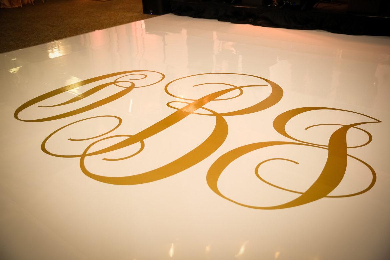 Elegant_Event_Lighting_Chicago_Cultural_Center_Wedding_Gold_Monogram_Vinyl_White_Dance_Floor