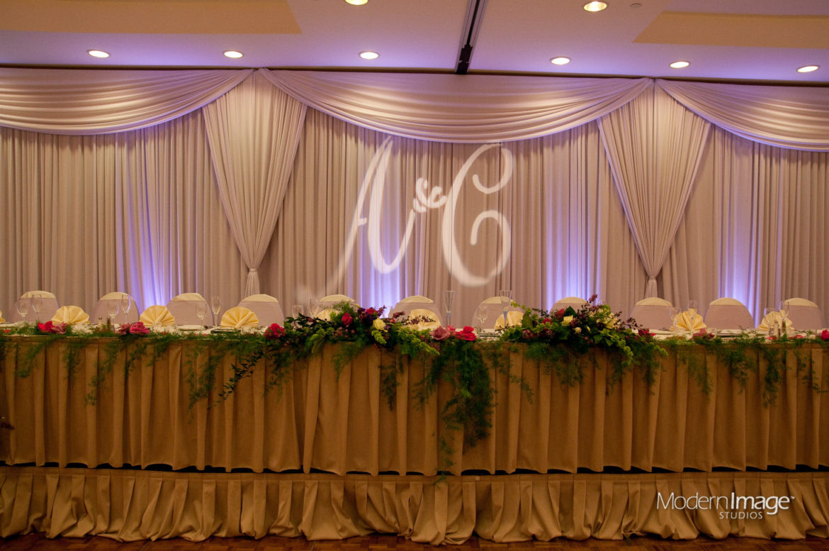 Elegant_Event_Lighting_Chicago_Double_Tree_Arlington_Heights_Wedding_Head_Table_Backdrop_Ivory_Draping_LED_Uplighting_Purple
