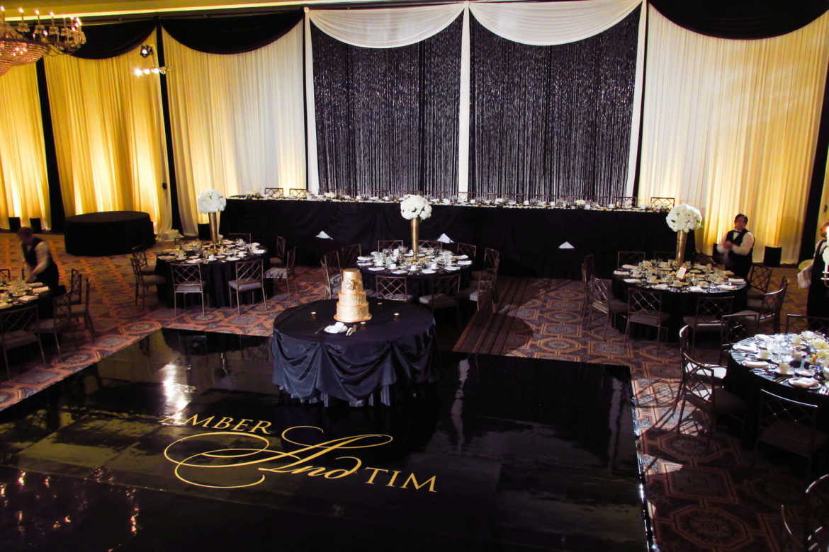 Elegant_Event_Lighting_Chicago_Drury_Lane_Oak_Brook_Wedding_Crystal_Curtain_Backdrop_Gold_Uplighting_Black_Dance_Floor_Vinyl_Monogram