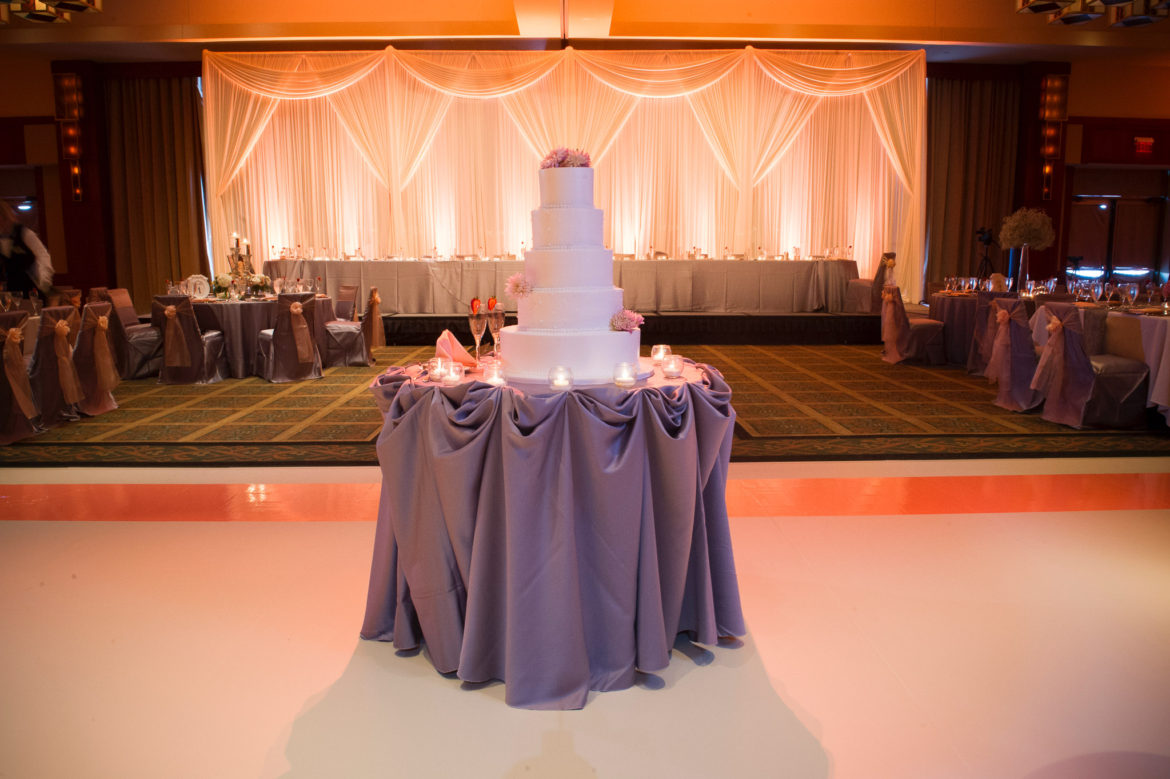 Elegant_Event_Lighting_Chicago_Eaglewood_Resort_Spa_Itasca_Wedding_Ivory_Dance_Floor_Matte_Amber_Draping_LED_Uplighting_Backdrop