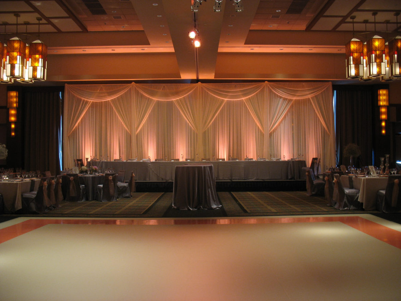 Elegant_Event_Lighting_Chicago_Eaglewood_Resort_Spa_Itasca_Wedding_Ivory_Dance_Floor_Matte_Amber_Draping_LED_Uplighting_Backdrop
