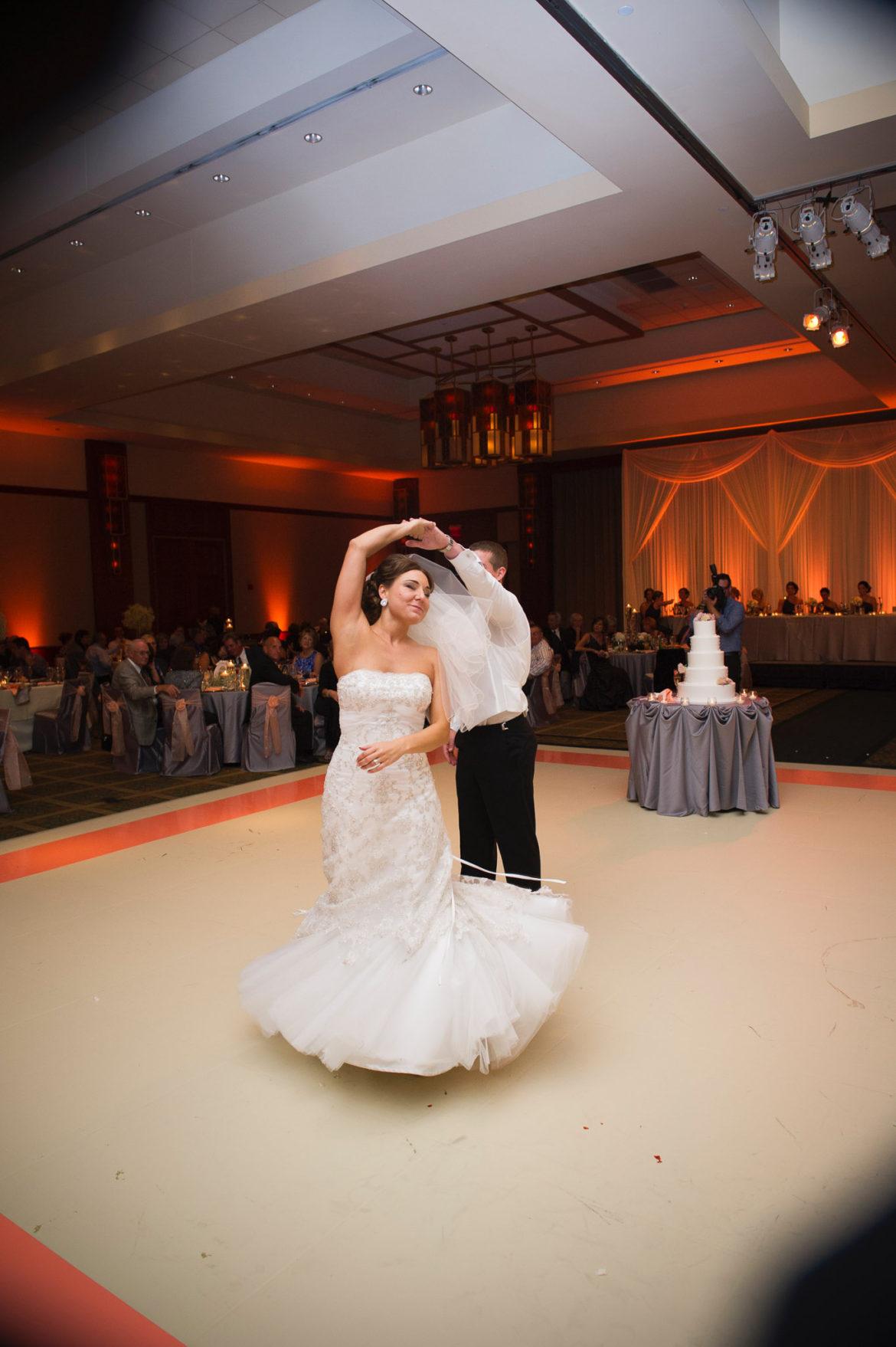 Elegant_Event_Lighting_Chicago_Eaglewood_Resort_Spa_Itasca_Wedding_Ivory_Matte_Dance_Floor_First_Dance_Amber_LED_Uplighting