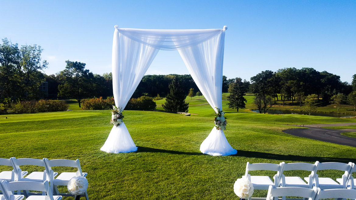 Elegant_Event_Lighting_Chicago_Eaglewood_Resort_Spa_Itasca_Wedding_Outdoor_Arch_White_Ceremony