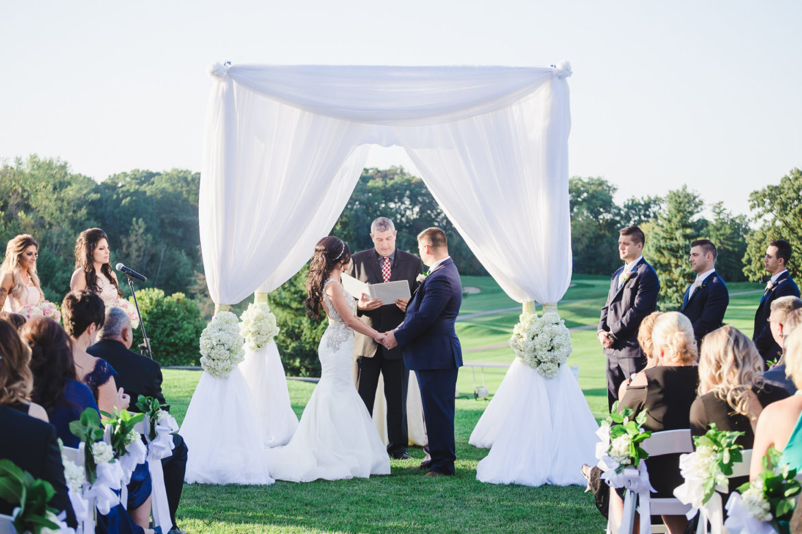 Elegant_Event_Lighting_Chicago_Eaglewood_Resort_Spa_Itasca_Wedding_Outdoor_Arch_White_Ceremony_Bride_Groom