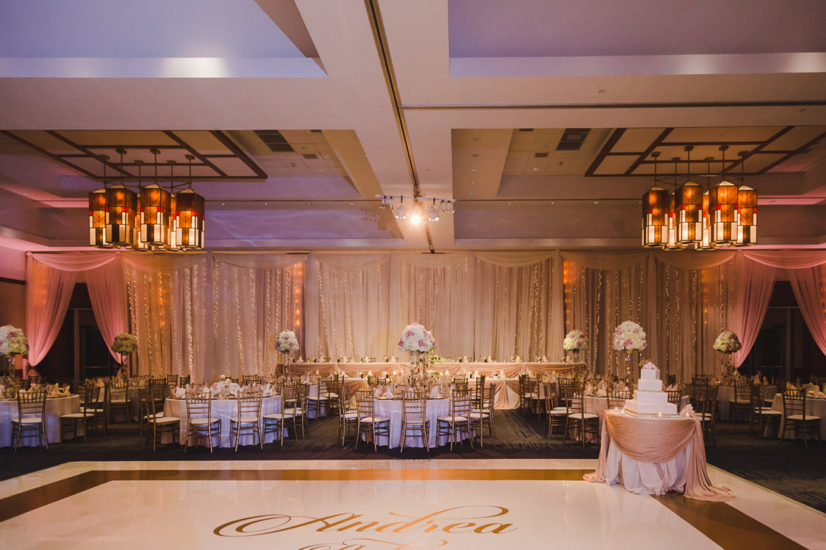 Elegant_Event_Lighting_Chicago_Eaglewood_Resort_Spa_Itasca_Wedding_Twinkle_Light_Draping_Backdrop_Romantic_White_DAnce_Floor_Vinyl_Monogram_Gold_Table_Draping