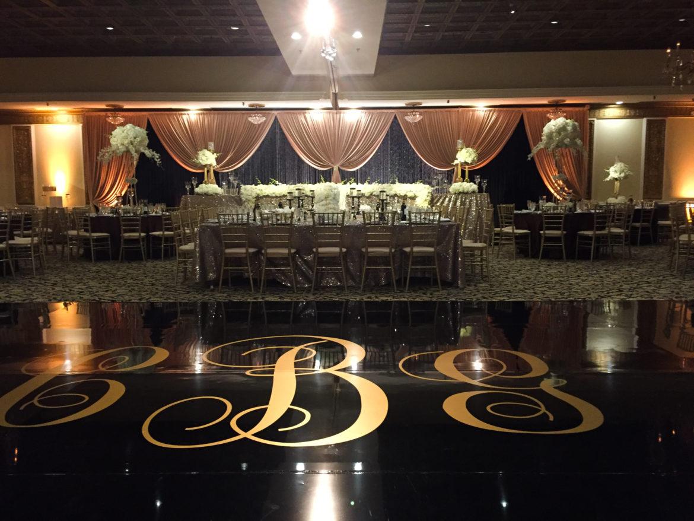 Elegant_Event_Lighting_Chicago_Fountain_Blue_Des_Plaines_Wedding_Amber_Uplighting_Gold_Draping_Black_Backdrop_Black_Vinyl_Dance_Floor_Monogram