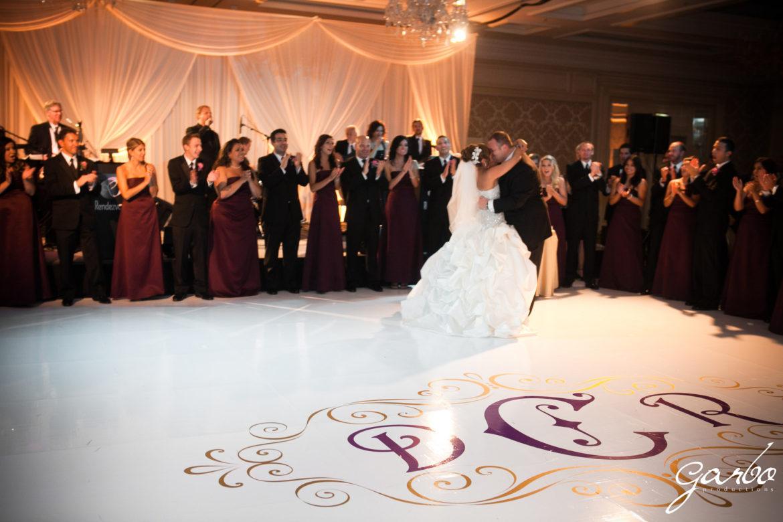 Elegant_Event_Lighting_Chicago_Four_Seasons_Wedding_First_Dance_White_Dance_Floor_Monogram