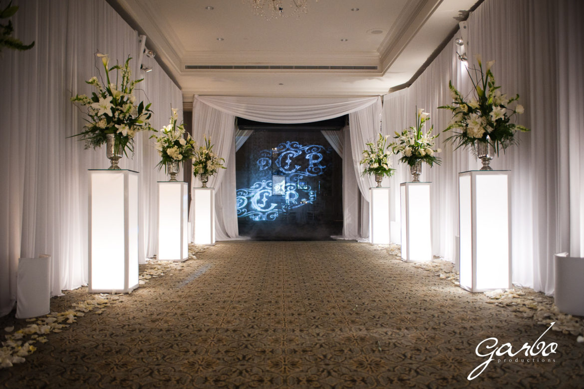 Elegant_Event_Lighting_Chicago_Four_Seasons_Wedding_Fog_Machine_Cloud_Monogram_Shining_White_Draping_Soft_LED_Uplighting_Flower_Pedestals