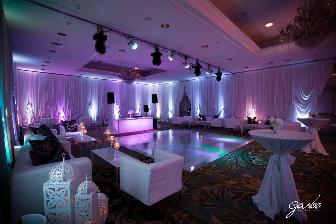 Elegant_Event_Lighting_Chicago_Four_Seasons_Wedding_Pastel_Purple_Lilac_Baby_blue_LED_Reception_Uplighting_White_Draping_Dance_Floor_Rainbow