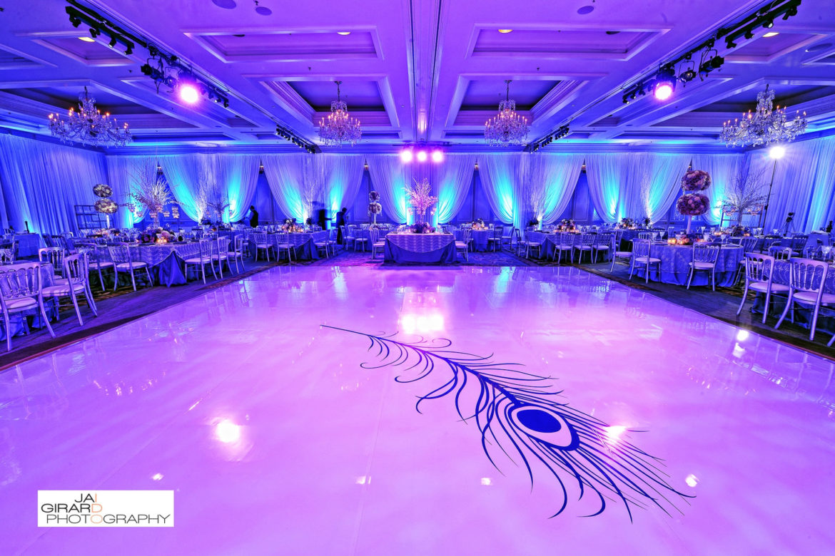 Elegant_Event_Lighting_Chicago_Four_Seasons_Wedding_Peacock_White_Dance_Floor_Blue_LED_Uplighting_Draping_Reception