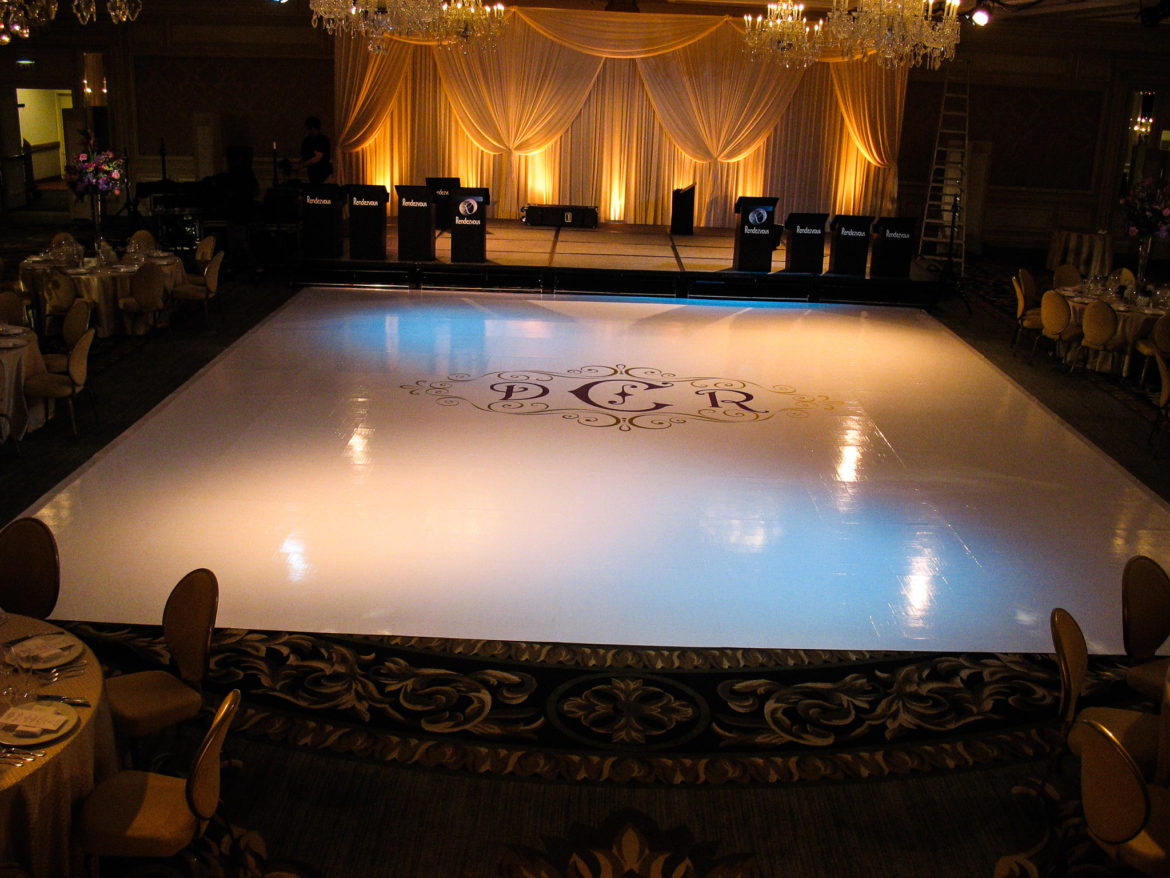 Elegant_Event_Lighting_Chicago_Four_Seasons_Wedding_White_Dance_Floor_Cover_Monogram_Ivory_Backdrop_Amber_Uplighting